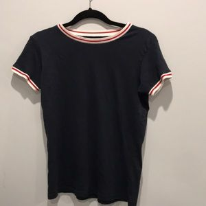 Navy blue shirt w red and white collar and cuffs